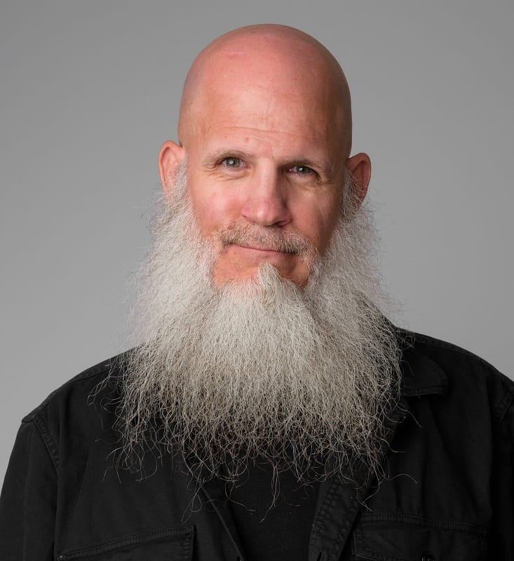 bald man with grey beard