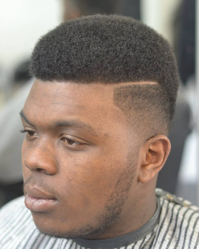 Medium Size Afro with Side Part and Fade