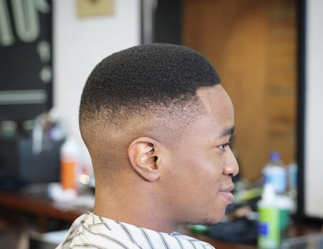 Natural Afro Texture and Sharp Fade