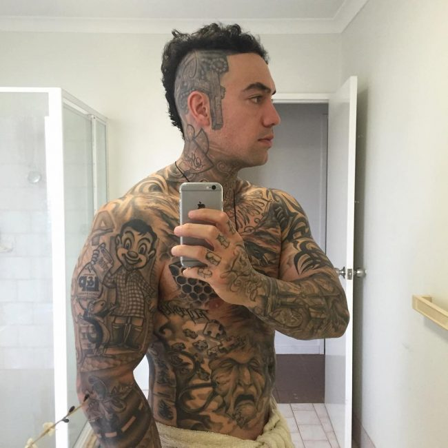 Tattooed Mohawk with Curly Top