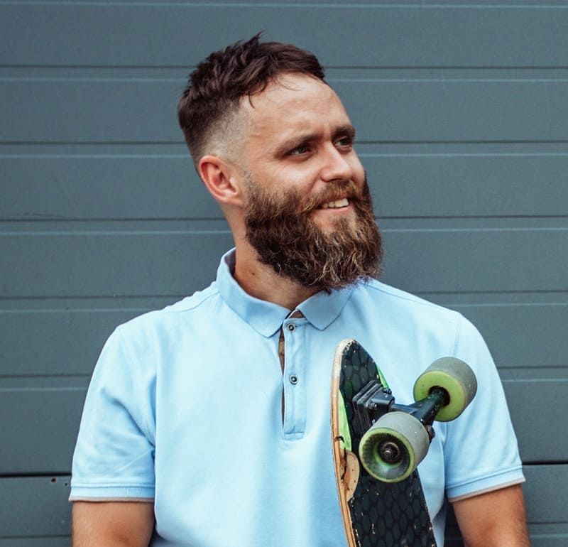 hipster guy's beard fade style