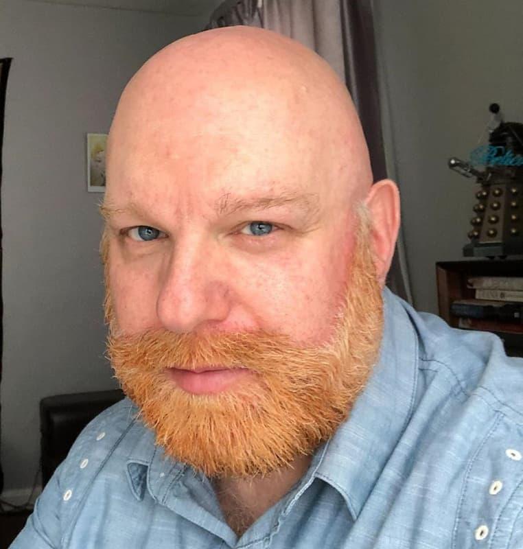 bald man with blonde beard