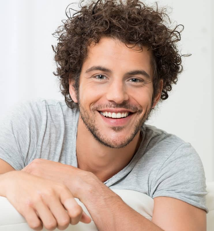 short curly hairstyle for men