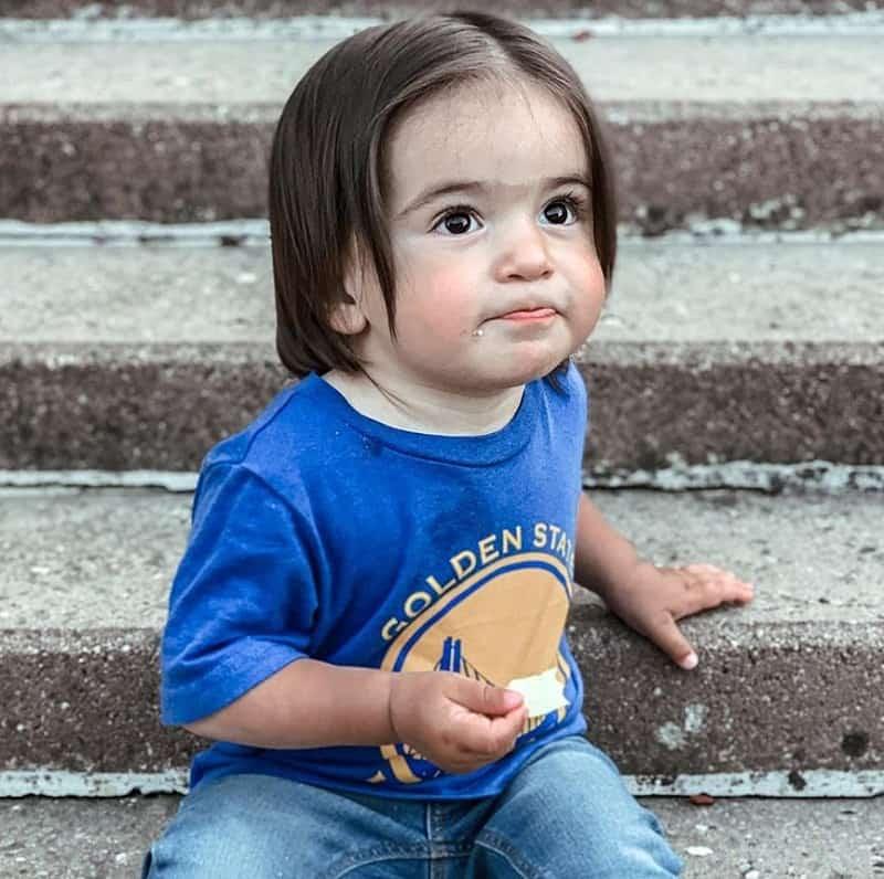 little boy with long hair
