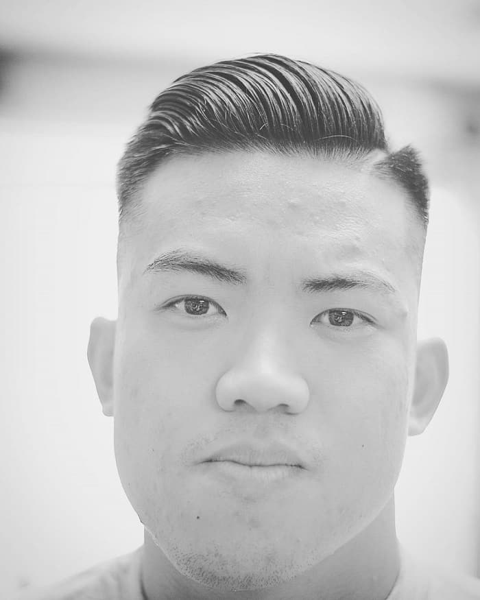 marine haircut with hard part