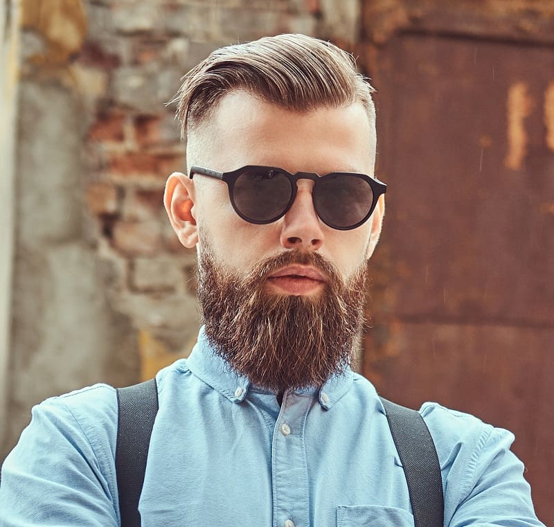 hipster guy with comb over fade haircut