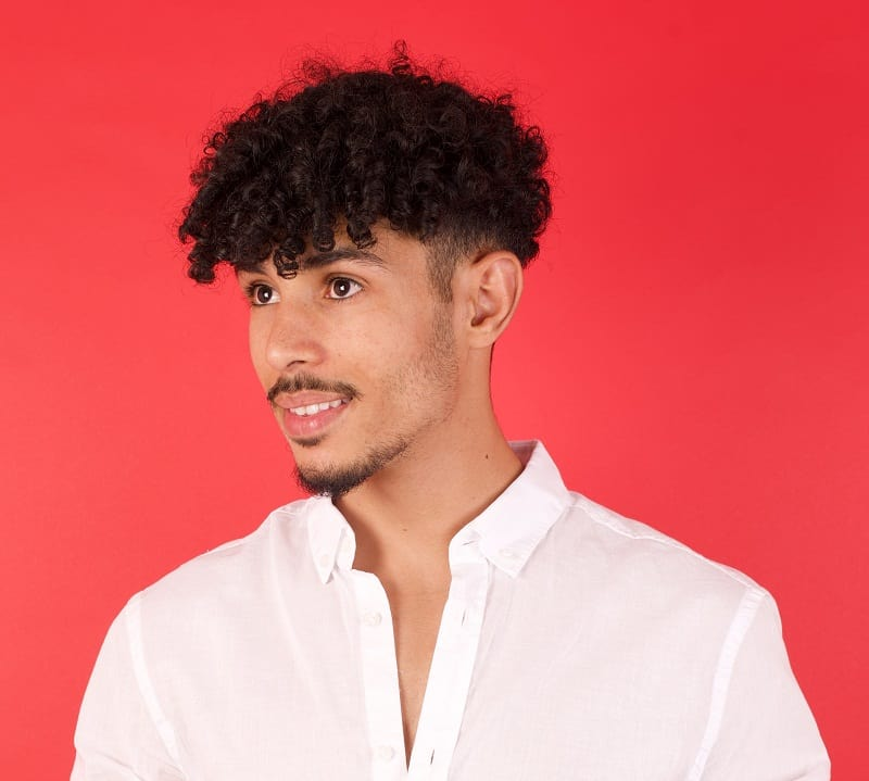 curly mushroom hairstyle for guys