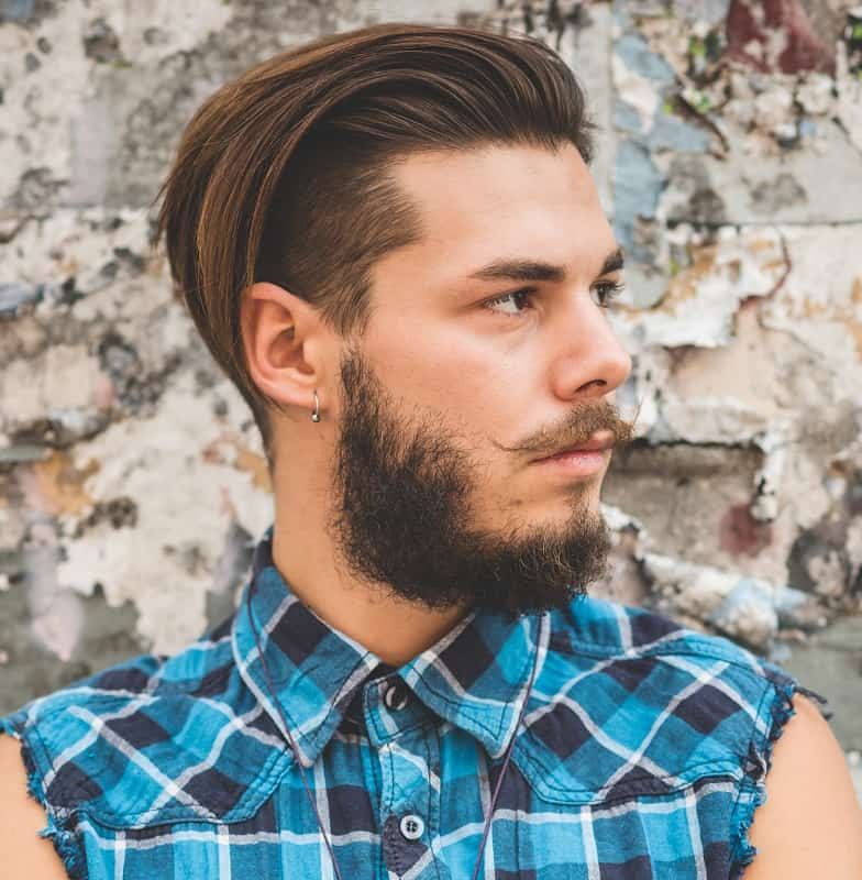 hipster guy with long top and short sides hairstyle