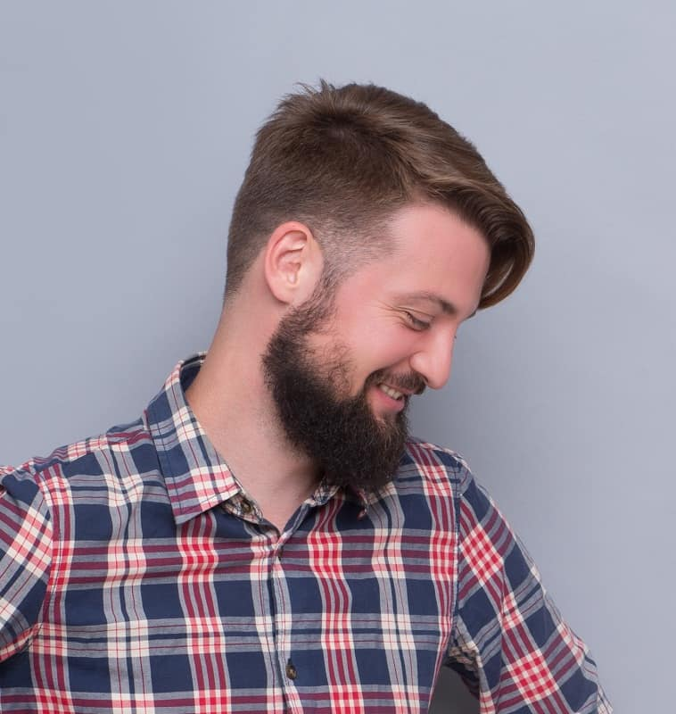 sideswept hairstyle with beard