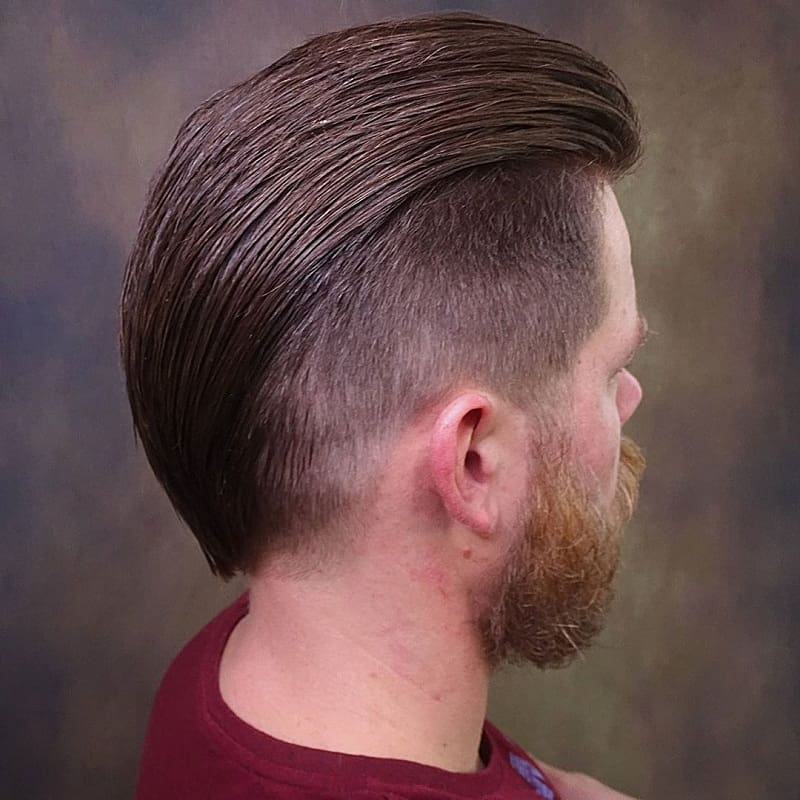 slicked back hair with undercut