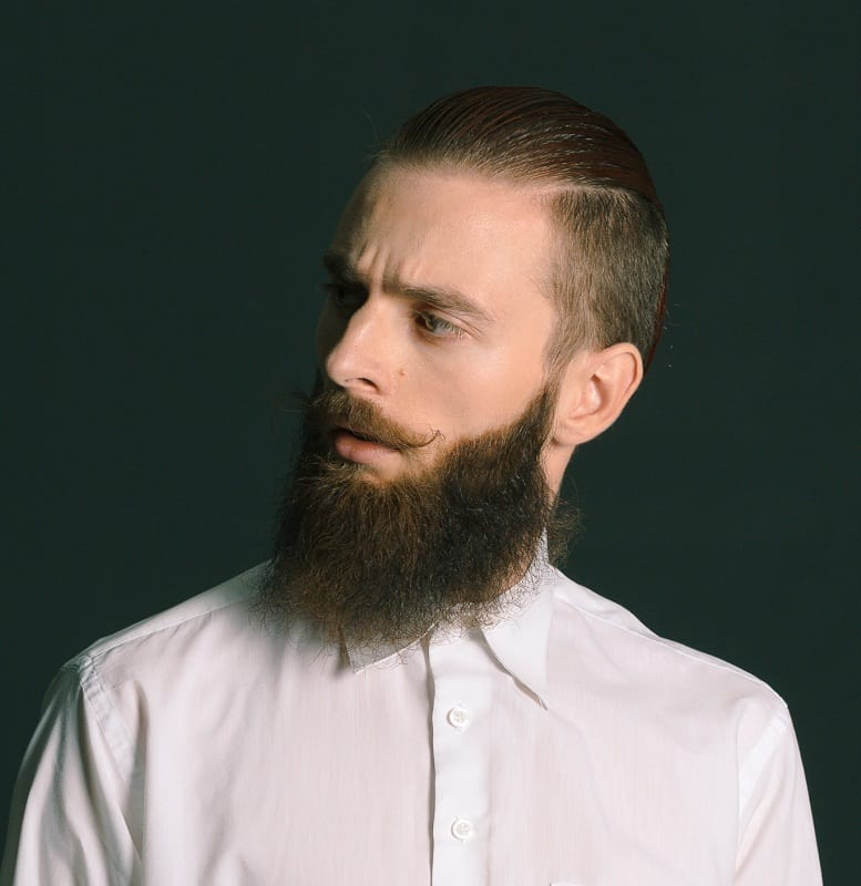 hipster guy with slicked back undercut