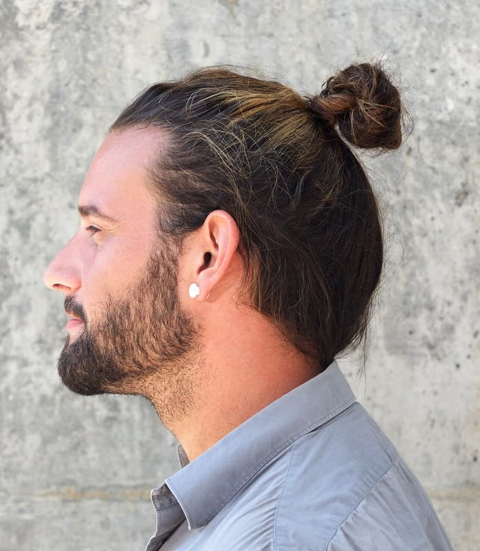 guy with top knot hair