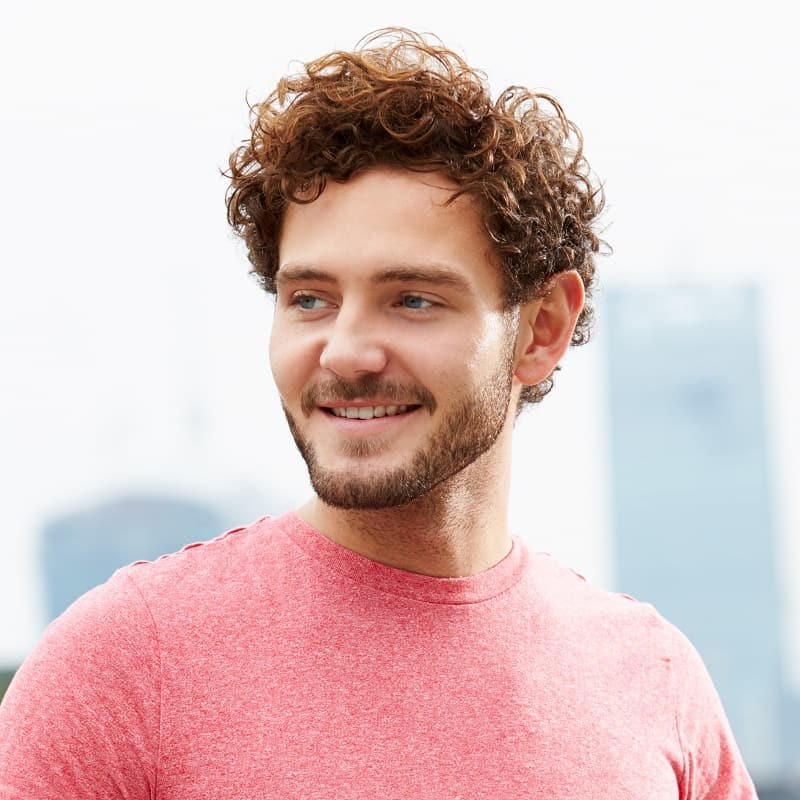 widows peak hairstyle for men with curly hair